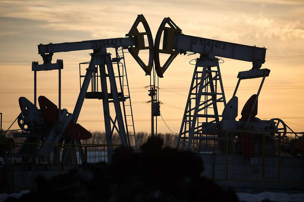 """Oil pumping jacks, also known as """"nodding donkeys"""", operate in an oilfield near Almetyevsk, Tatarstan, Russia, on Wednesday, March 11, 2020. Saudi Aramco plans to boost its oil-output capacity for the first time in a decade as the world's biggest exporter raises the stakes in a price and supply war with Russia and U.S. shale producers. Photographer: Andrey Rudakov/Bloomberg"""