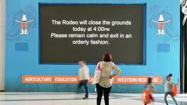 Remain calm and exit in an orderly fashion reads a sign at the Houston Livestock Show and Rodeo, Wednesday, March 11, 2020, at NRG Center in Houston. Officials announced the rodeo will be closing at 4pm on Wednesday.