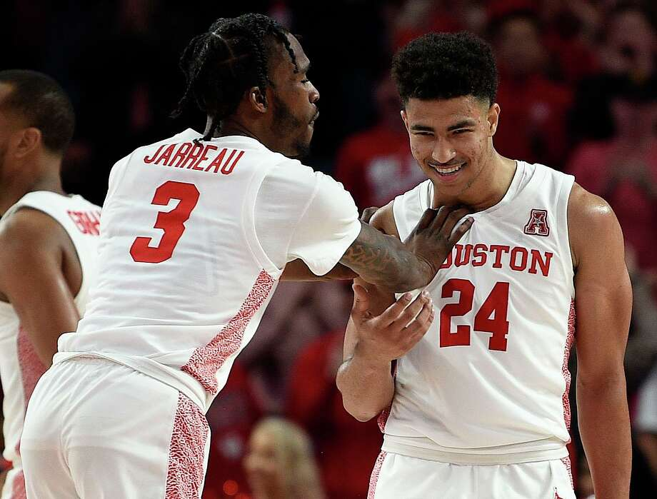 Houston guard Quentin Grimes (24) celebrates his three point basket with guard DeJon Jarreau during the second half of an NCAA college basketball game against Memphis, Sunday, March 8, 2020, in Houston. Photo: Eric Christian Smith / Contributor / Houston Chronicle