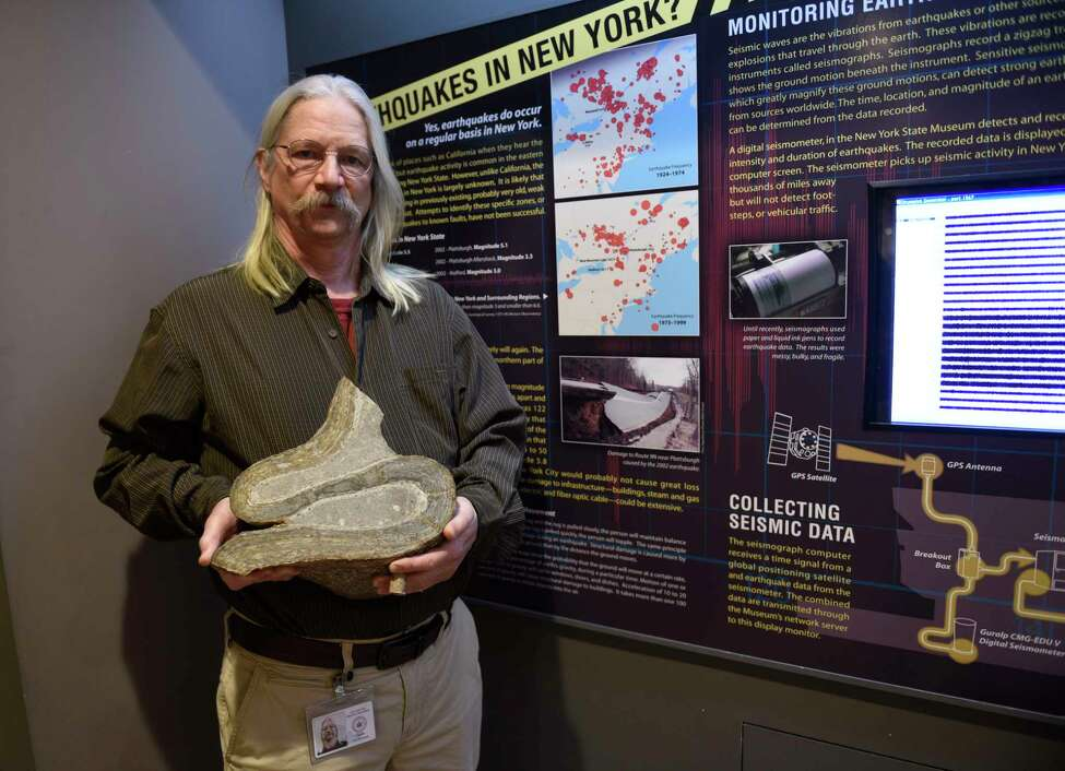 Dr. Chuck Ver Straeten, curator of sedimentary rocks at the New York State Museum, holds a rock that shows a very slow earth movement unlike an earthquake that happens faster and causes the earth shift fastert on Wednesday, March 11, 2020 in Albany, N.Y. (Lori Van Buren/Times Union)