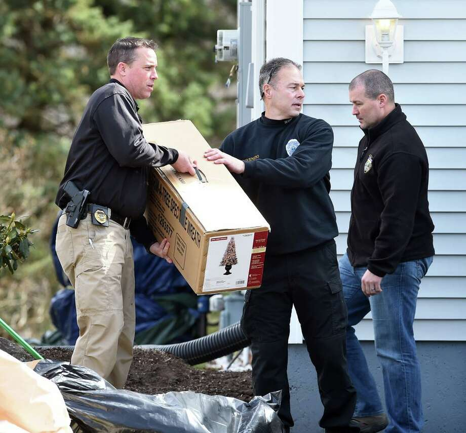 West Haven police remove items from the home of former West Haven High School Athletic Director Jonathan P. Capone at 326 Benham Hill Road in West Haven on March 11, 2020. Photo: Arnold Gold / Hearst Connecticut Media / New Haven Register