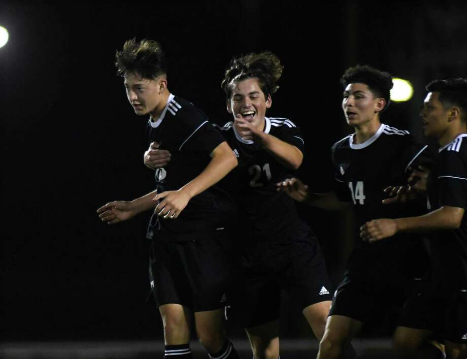 Tomball freshman forward Mauricio Ramirez, from left, celebrates his goal scored against Porter with teammates Daniel Pedraze and Ismael Betancourt during the second period of their district matchup at Tomball High School on March 9, 2020. Photo: Jerry Baker, Houston Chronicle / Contributor / Houston Chronicle