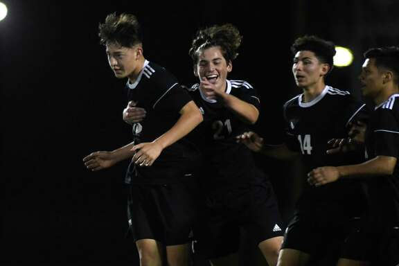 Tomball freshman forward Mauricio Ramirez, from left, celebrates his goal scored against Porter with teammates Daniel Pedraze and Ismael Betancourt during the second period of their district matchup at Tomball High School on March 9, 2020.