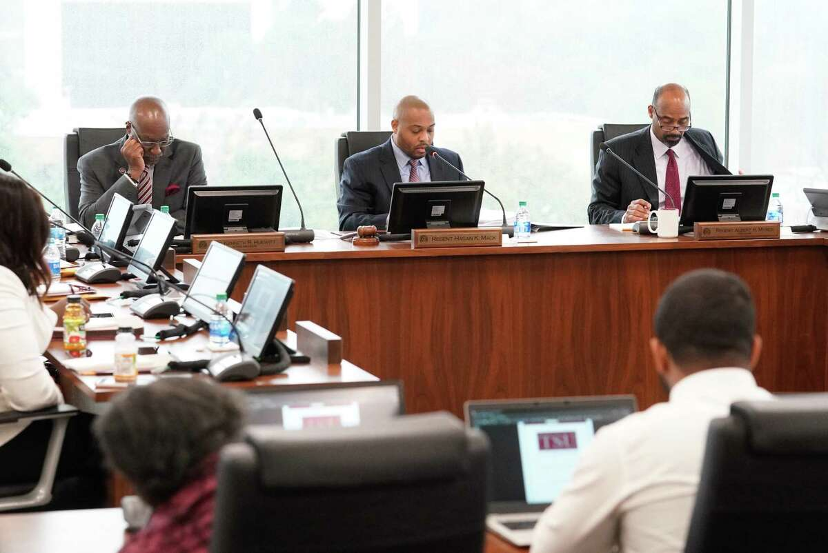 From left, acting president Kenneth Huewitt, board chair Hasan Mack, and vice chair Albert Myers appear at a TSU board meeting in February 2020.