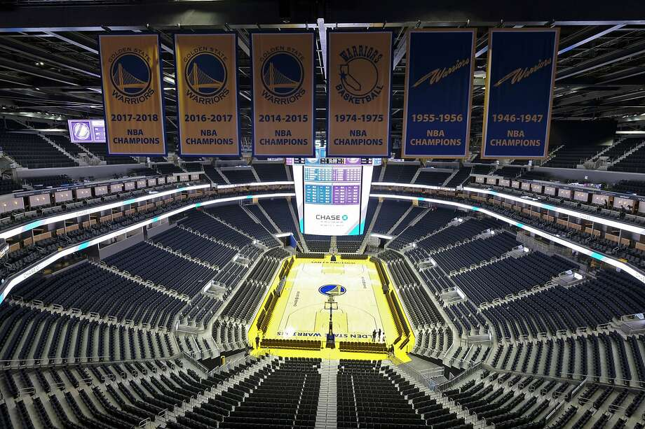 FILE - In this Aug. 26, 2019, file photo, the Golden State Warriors championship banners hang above the seating and basketball court at the Chase Center in San Francisco. The Warriors will play the Brooklyn Nets at home Thursday night, March 12, 2020, in the first NBA game without fans since the outbreak of the coronavirus. (AP Photo/Eric Risberg, File) Photo: Eric Risberg / Associated Press