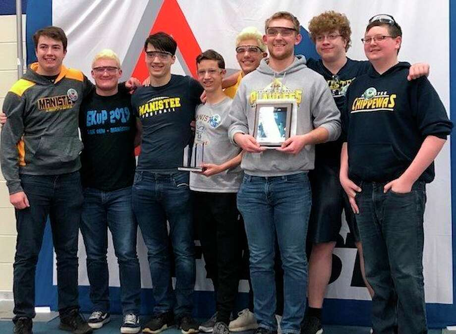 The Manistee High School Robotics team proudly pose with the two awards they won at the Robotics First competition at St. Joseph High School. The team was honored for being the Rookie team with the most points and for being the Rookie All Star team. (Courtesy photo)