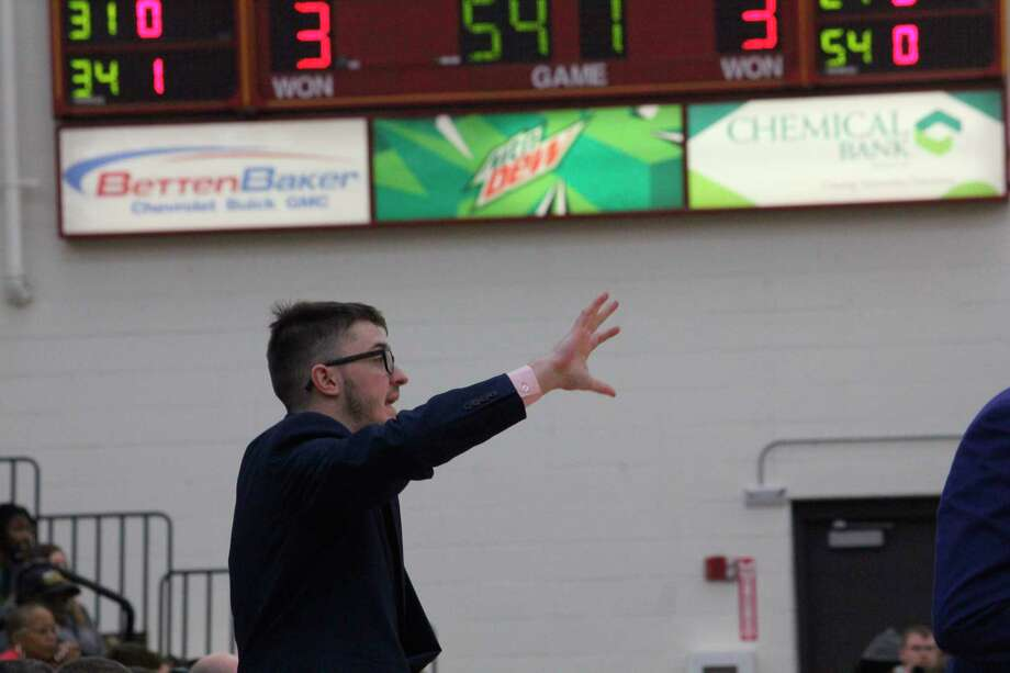 Former Morley Stanwood basketball player Tim Cairnduff, now a coach for Lake Superior State, points something out to a player on Feb. 27 while the Lakers were playing at Ferris State. (Pioneer photo/John Raffel)