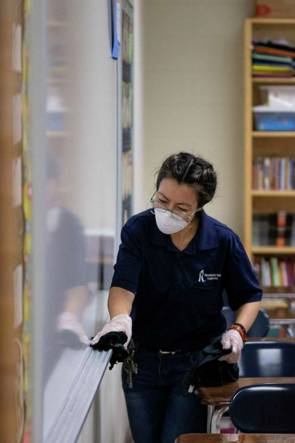 A worker wipes down a white board at Dolph Briscoe Middle School earlier this month as part of extra cleaning due to Covid-19. Ensuring children have access to food has to be a priority in the event of school closures.