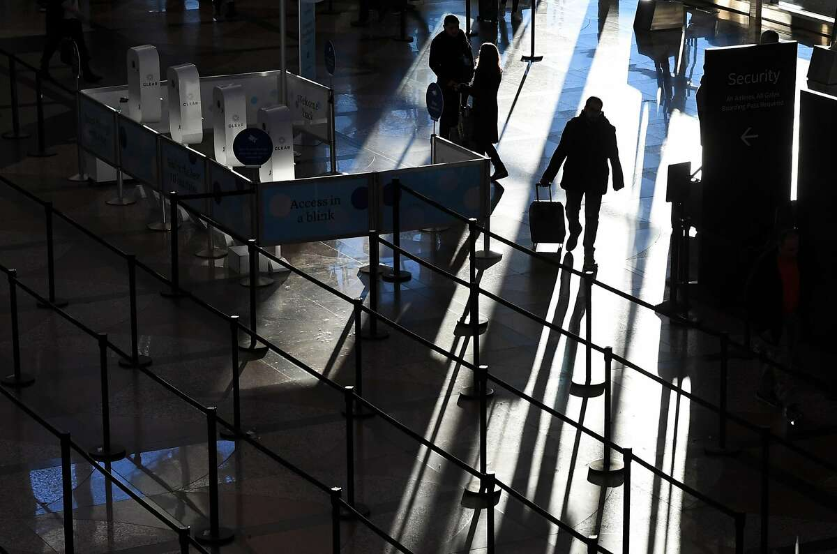 DENVER CO - JANUARY 14: A traveler heads into the security line at Denver International Airport as TSA agents continue to work without pay, after 24 days of the partial government shutdown, on January 14, 2019 in Denver, Colorado. Colorado democrat dignitaries held a press conference at Denver International Airport in support of ending partial government shutdown. (Photo by RJ Sangosti/The Denver Post via Getty Images)