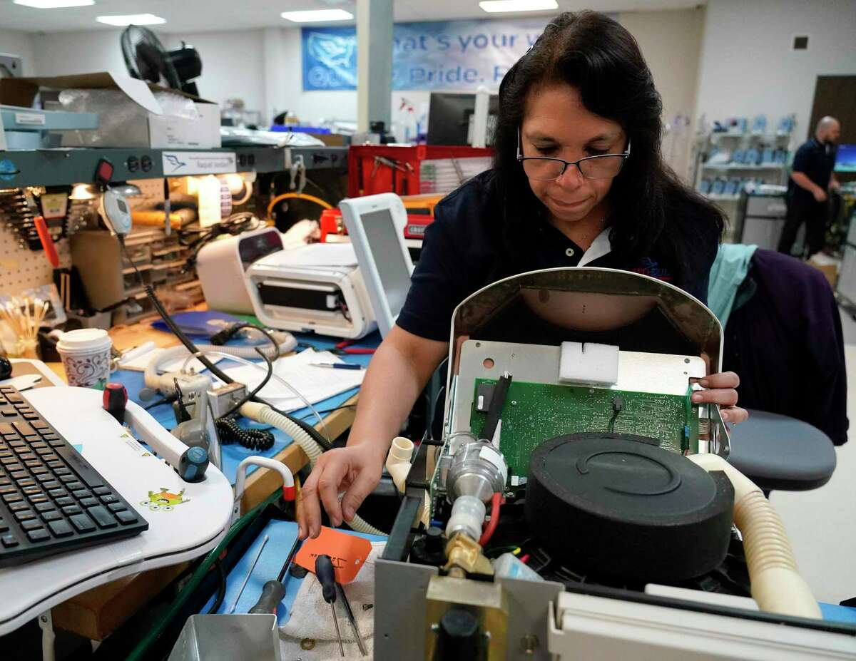 Raquel Jordan, a biomedical tech, works on equipment at US Med-Equip, 7028 Gessner Rd., Tuesday, Feb. 18, 2020, in Houston. US Med-Equip is a major supplier of movable medical devices such as respirators, infusion equipment and neo-natal incubators, to hospitals and other health care facilities across the country.