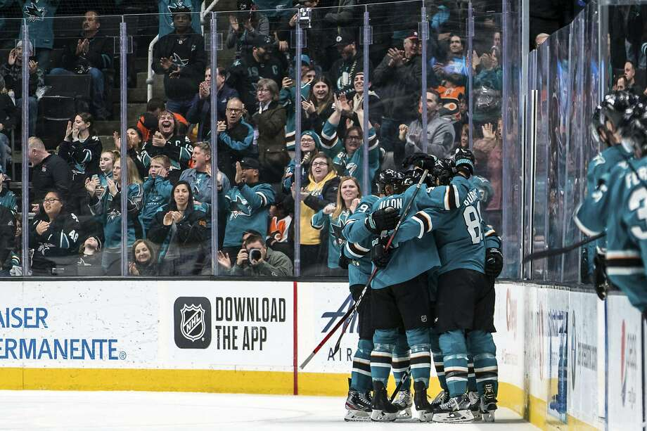 Sharks right wing Timo Meier is embraced by teammates after his goal in a December game against the Flyers. If Meier scores in any of the Sharks' next three homes games, there won't be any fans there to join in the celebration. Photo: John Hefti / Associated Press 2019
