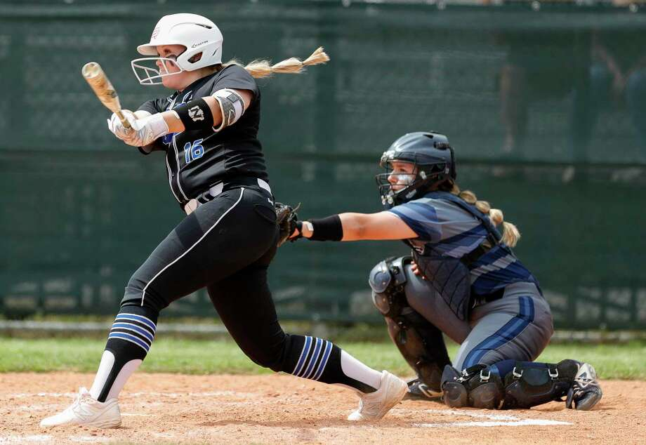 Kennedy Reynolds #16 of Oak Ridge hits a solo home run during the first inning of a District 15-6A high school softball game at College Park High School, Wednesday, March 11, 2020, in The Woodlands. Photo: Jason Fochtman, Houston Chronicle / Staff Photographer / Houston Chronicle  © 2020