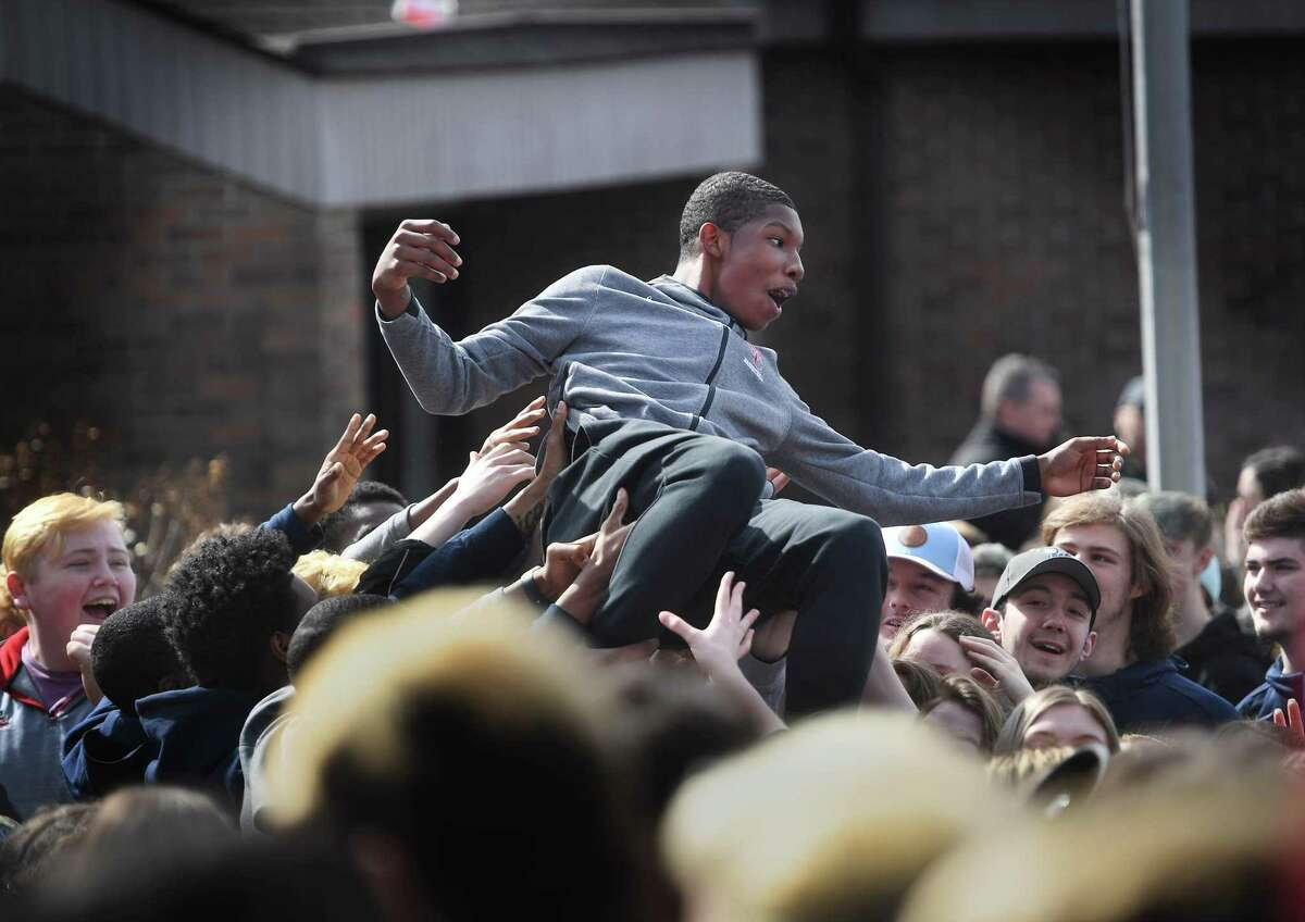 Student-athletes engage in crowd surfing during a protest outside of the CIAC offices in Cheshire on Wednesday.