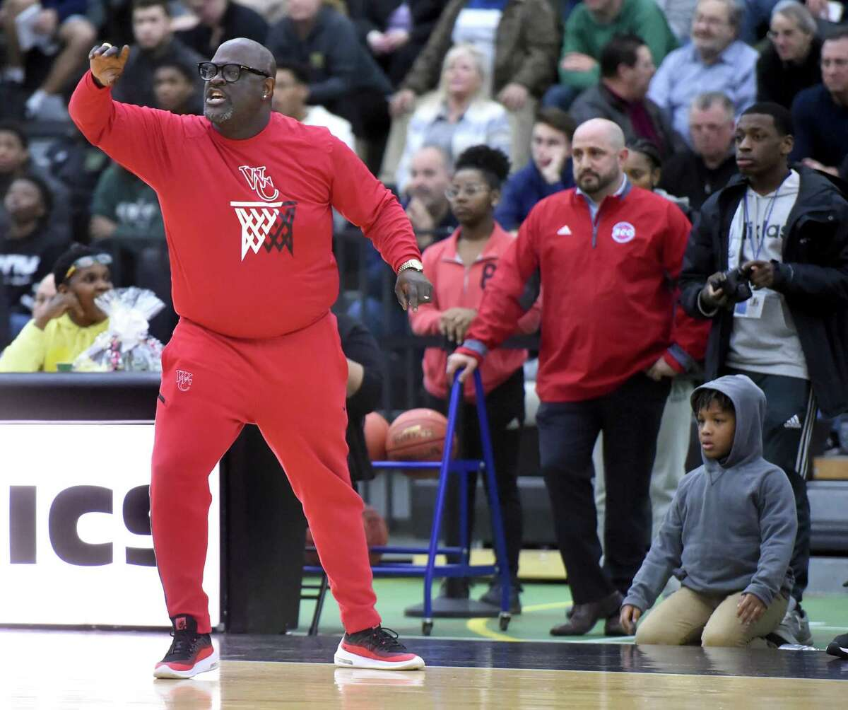 Wilbur Cross Head Coach Kevin Walton directs his players near the end of the SCC Boys Basketball Championship against Notre Dame of West Haven at the Floyd Little Athletic Center in New Haven on March 4, 2020. Wilbur Cross won 49-48.