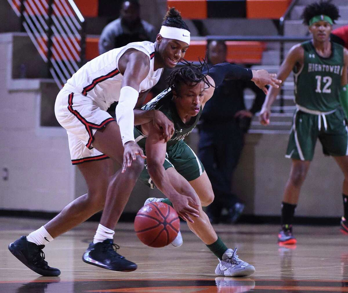 Hightower guard Chris Harris, stealing the ball against Port Arthur Memorial, is one of the many players not named Bryce Griggs that contributes to team's success.