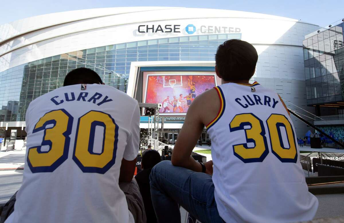 Fans camp out in front of the new Chase Center before the Golden State Warriors' season-opening NBA basketball game on Thursday, Oct. 24, 2019 in San Francisco, Calif.