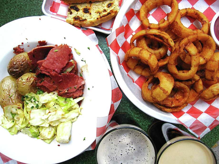 Corned beef and cabbage, soda bread, Black & Tan onion rings and Irish beers from Durty Nelly's Irish Pub at the Hilton Palacio del Rio on the River Walk in San Antonio. Photo: Mike Sutter / San Antonio Express-News