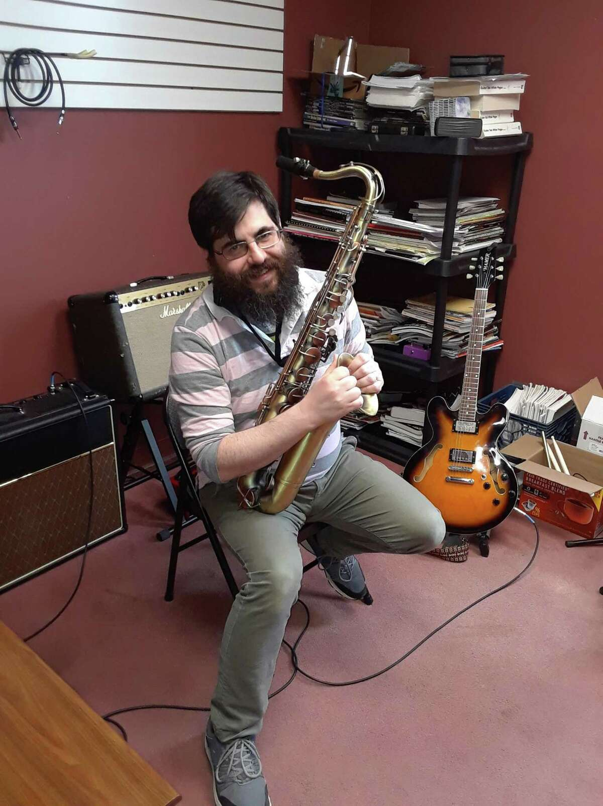 Musician John Ambrose teaches students on a variety of woodwind and reed instruments as well as guitar and brass. His first love is the saxophone.