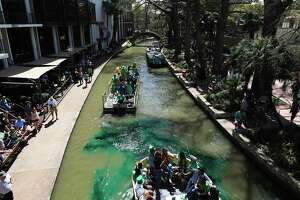 Emerald green dye is sprayed from a barge along the San Antonio River on March 16, 2018. The San Antonio River has been dyed green in honor of St. Patrick's Day since 1968.