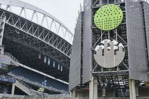CenturyLink Field, where MLS soccer's Seattle Sounders and the XFL's Seattle Dragons play home games, sits empty, Wednesday, March 11, 2020, in Seattle.  In efforts to slow the spread of the COVID-19 coronavirus, Washington State Gov. Jay Inslee announced a ban on large public gatherings in three counties in the metro Seattle area. That decision impacts the Seattle Mariners, Seattle Sounders, and the XFL's Seattle Dragons home games. (AP Photo/Stephen Brashear)
