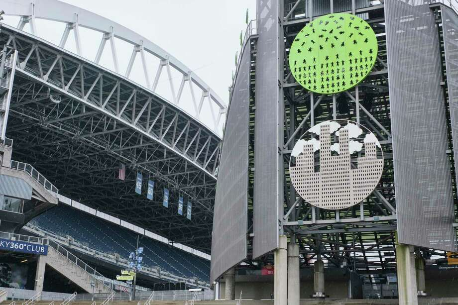 CenturyLink Field, where MLS soccer's Seattle Sounders and the XFL's Seattle Dragons play home games, sits empty. In efforts to slow the spread of the COVID-19 coronavirus, Washington State Gov. Jay Inslee announced a ban on large public gatherings in three counties in the metro Seattle area. That decision impacts the Seattle Mariners, Seattle Sounders, and the XFL's Seattle Dragons home games. Photo: Stephen Brashear, FRE / Associated Press / Copyright 2020 The Associated Press. All rights reserved.