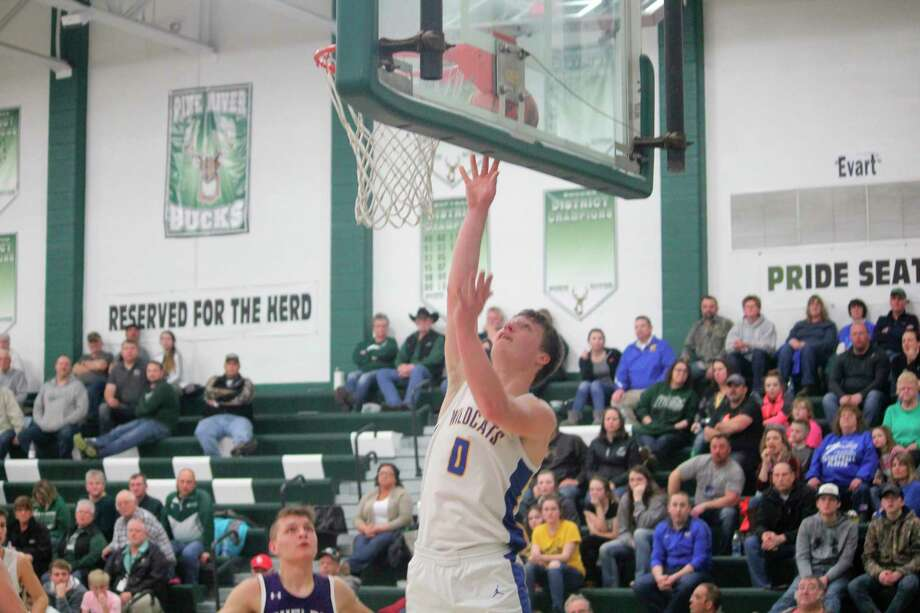 Evart's Donavin Reagan goes up for the shot against Shelby on Wednesday. (Pioneer photo/John Raffel)
