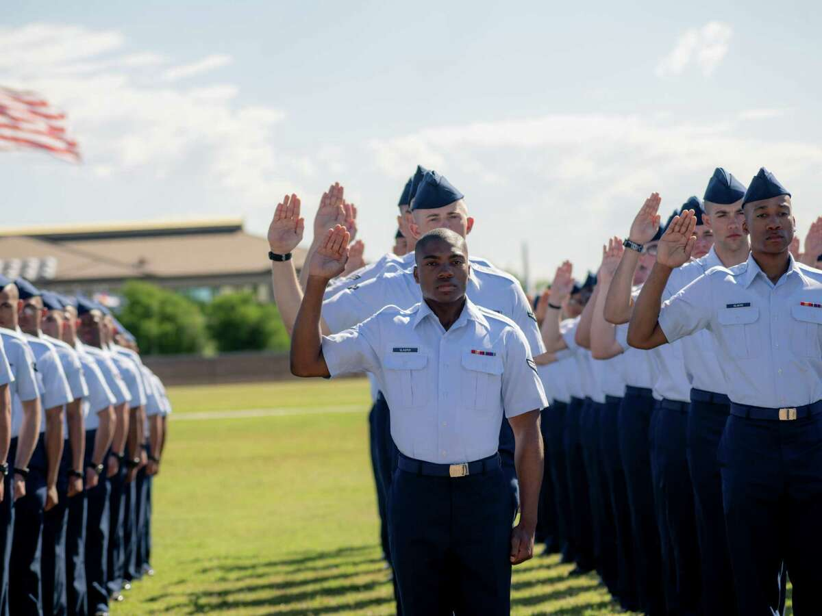 Airmen take their oaths at Joint Base San Antonio-Lackland during the military's Fiesta celebration and basic training graduation in San Antonio, Texas on Friday, April 19, 2019.