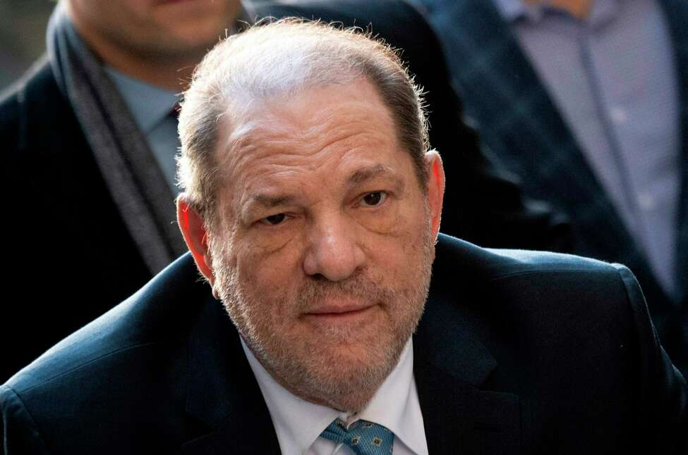 (FILES) In this file photo taken on February 24, 2020 Harvey Weinstein arrives at the Manhattan Criminal Court in New York City. - On March 11, 2020, a week before his 68th birthday, the