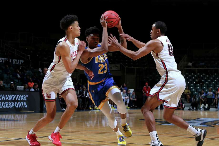 Lamar's David Muoka (left) and T.J. Atwood (right) defend the ball during the Cardinals' first-round win over McNeese Wednesday in the Southland tournament. Photo: Erik Williams, Provided By The Southland Conference