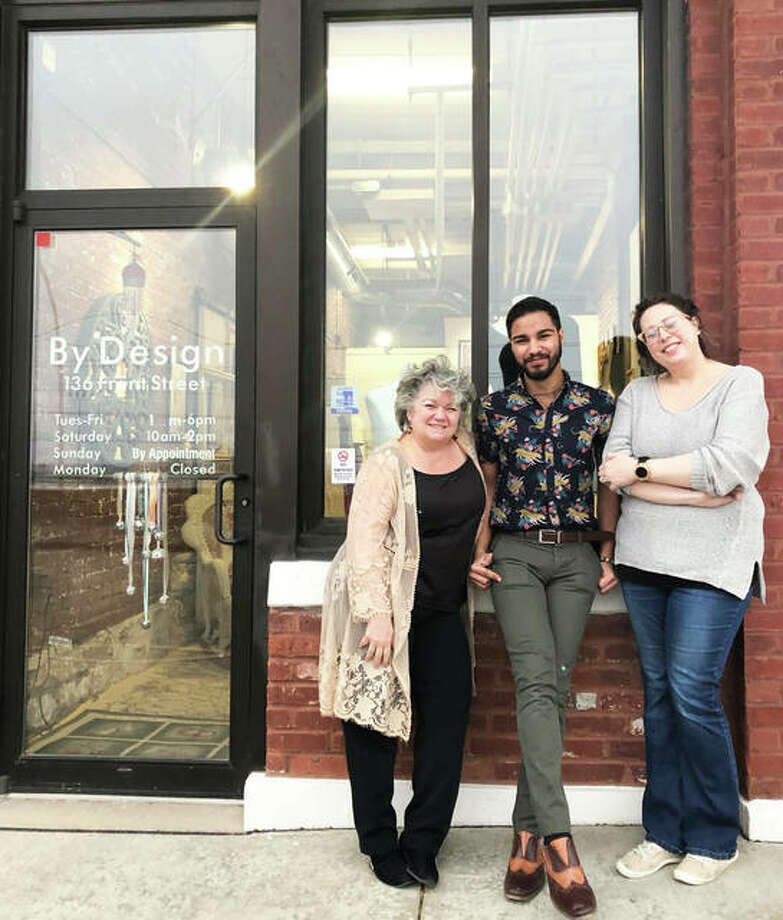 "The Alton-based By Design School of Fashion team, left to right, founder Lillian Bates, of Alton, design intern Nathan Beilsmith, of Brighton, and part-time designer Rhianon Harvey, of Godfrey, at the By Design studio, 136 Front St., Alton. The team will present an interactive experience during the opening of ""Renderings to Reality,"" an exhibition on view through Friday, April 10. Photo: For The Telegraph"