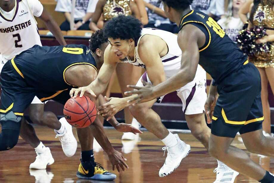 Quentin Scott steals the ball and bursts into the open court for the Bobcats as Texas State plays Appalahian State in the opening conference tournament basketball game on Feb. 11, 2020. Photo: Tom Reel, San Antonio Express-News / Staff Photographer / **MANDATORY CREDIT FOR PHOTOG AND  SAN ANTONIO EXPRESS-NEWS/NO SALES/MAGS OUT/TV
