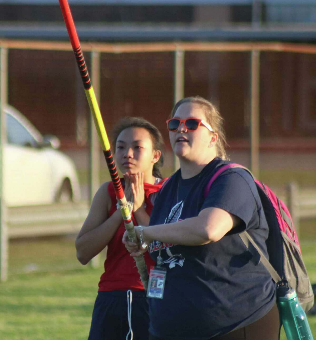 No, Bondy coach Michelle Nettles isn't about to pole vault. But she is trying to give Holly Tran a pointer before Tran attempts another vault during the intermediate school district track meet. Tran captured the district title at 5-6.