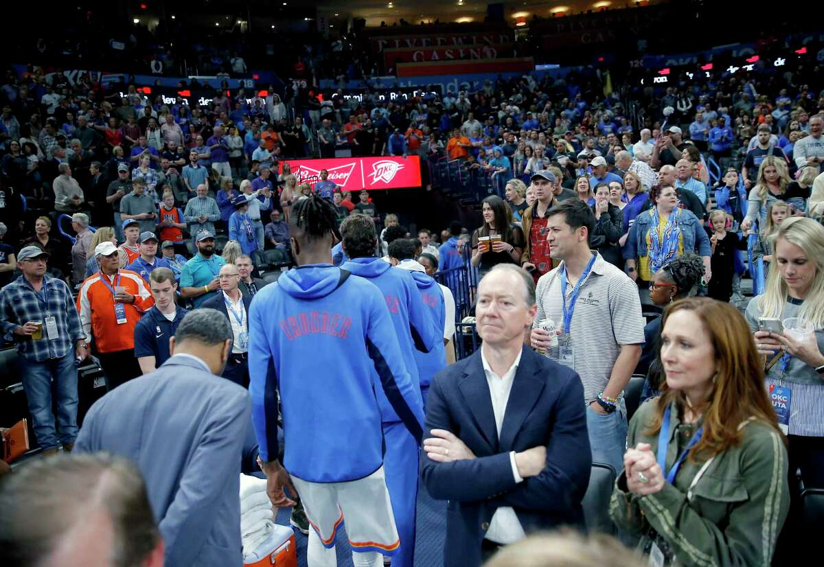 Thunder players leave the court after their game against the Jazz was halted moments before tipoff Wednesday night.