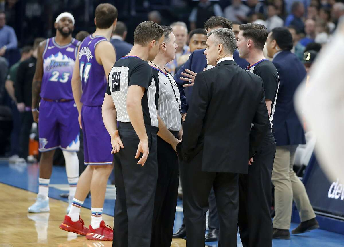 Oklahoma City coach Billy Donovan meets with officials before an NBA basketball game against the Utah Jazz was postponed in Oklahoma City, Wednesday, March 11, 2020.(Bryan Terry/The Oklahoman via AP)