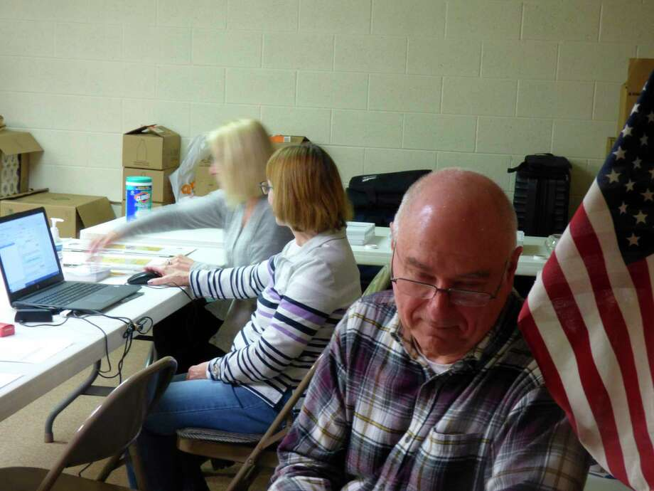 Poll workers wait for voters at a Manistee precinct, Tuesday, March 10. (Scott Fraley/News Advocate)