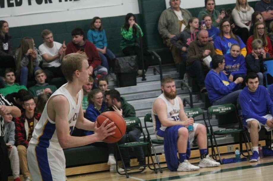 Evart's basketball season came to a close on Wednesday with a 61-55 loss to Shelby Photo: John Raffel