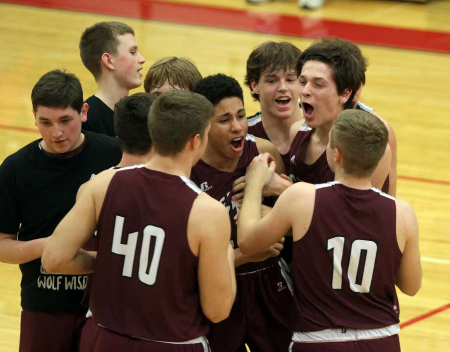 The Cass City boys basketball team upset the USA Patriots in the district semifinals by a score of 42-39 on Wednesday night. Photo: Eric Rutter/Huron Daily Tribune
