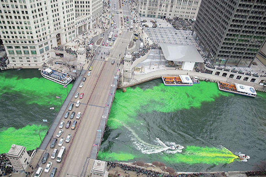 Boats move through the water as the Chicago River is dyed green in 2018 for St. Patrick's Day in Chicago. The city on Wednesday joined the growing ranks to cancel its Saturday St. Patrick's Day Parade amid concerns about the coronavirus. The city will not be dyeing the river green, either. Photo: Erin Hooley | Chicago Tribune (AP)