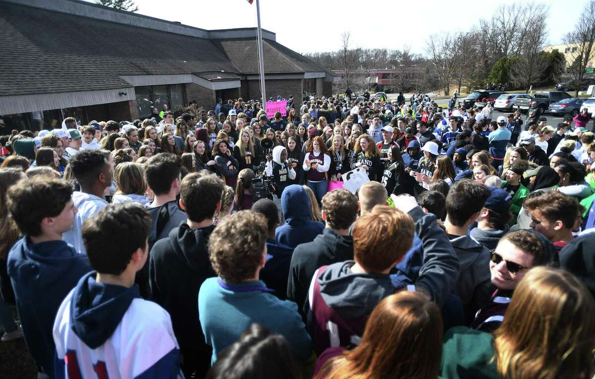 Hundreds of student athletes from around the state protest outside the front doors of CIAC offices in Cheshire, Conn. over the canceling of state playoffs in the wake of the coronavirus on Wednesday, March 11, 2020.