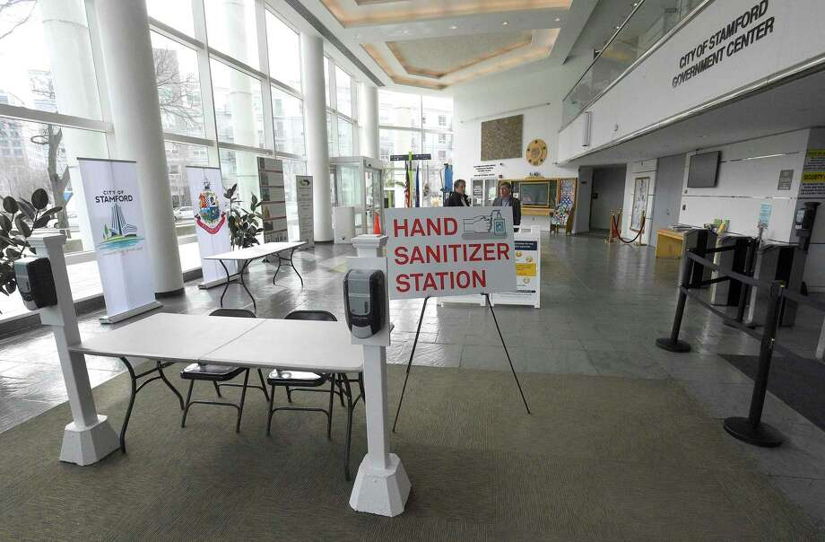 A hand sanitizer station is set up at the Stamford Government Center on March 11, 2020 in Stamford, Connecticut. Photo: Matthew Brown / Hearst Connecticut Media / Stamford Advocate