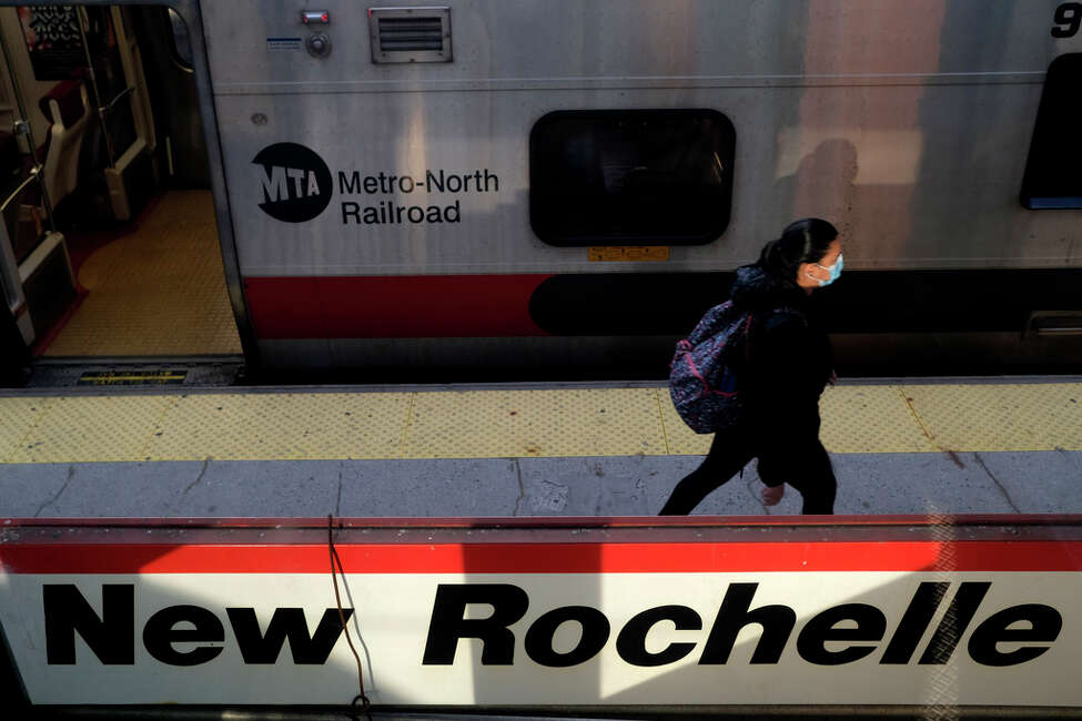 Commuters board a train bound for New York City at the New Rochelle Metro-North station in New Rochelle, N.Y., Thursday, March 12, 2020. State officials are shuttering several schools and houses of worship for two weeks in the New York City suburb and sending in the National Guard to help with what appears to be the nation's biggest cluster of coronavirus cases, Gov. Andrew Cuomo said Tuesday.