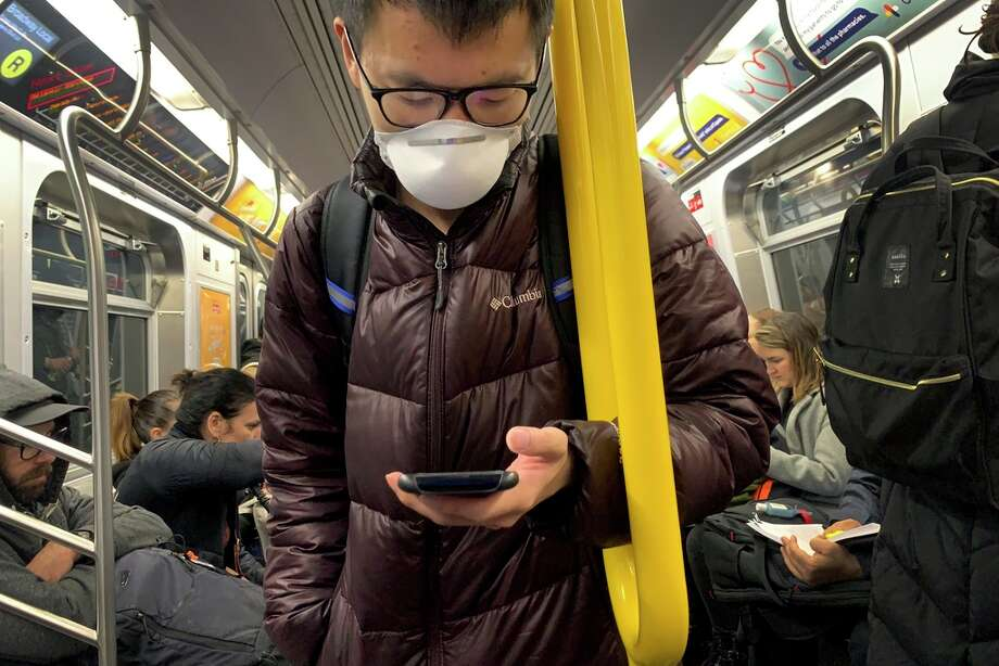 A commuter wears a mask while riding the subway at the start of a work day on Thursday, March 12, 2020, in the Brooklyn borough of New York. Mayor Bill de Blasio said Thursday he will announce new restrictions on gatherings to halt the spread of the new coronavirus in the coming days. The vast majority of people recover from the new coronavirus. According to the World Health Organization, most people recover in about two to six weeks, depending on the severity of the illness. Photo: Wong Maye-E, AP / Copyright 2020 The Associated Press. All rights reserved.