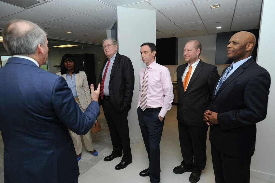 President of ISG Americas Todd Lavieri, left, gives a tour of the IT consulting and research firm's new offices on Atlantic St. in the Harbor Point area of Stamford, Conn. on Wednesday, May 9, 2018. Also pictured, from right, Chief of Staff to the mayor Michael Pollard, Director of Economic Development Thomas Madden, Director of Administration Michael Handler, Stamford mayor David Martin, and Rep. Gloria DePina (D-5). Photo: Hearst Connecticut Media / Stamford Advocate