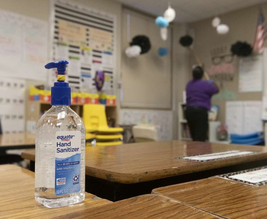 A bottle of hand santizier is seen as custodian Jessica Frear disinfects a classroom at Lincoln Elementary School, Thursday, March 12, 2020, in Montgomery. Photo: Jason Fochtman/Staff Photographer