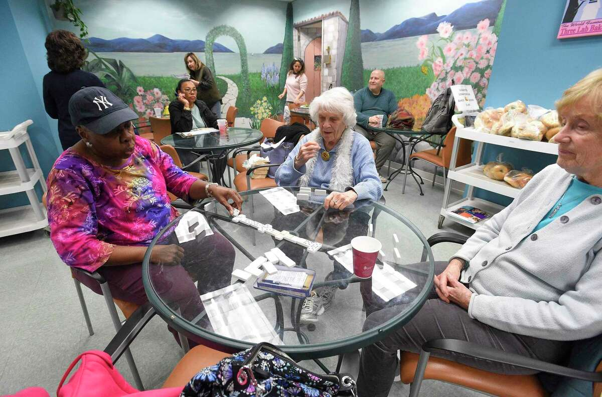 Seniors play a friendly game of Dominoes at the Stamford Senior Center on March 11, 2020 in Stamford, Connecticut. The senior center announced that it would be suspending all activities at the center located in the Stamford Government Center as city officials implement measures to combat the spread of COVID-19 Coronavirus.