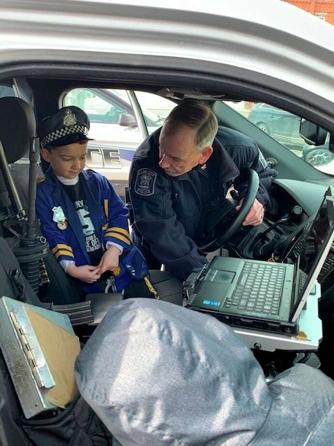 For his fifth birthday, Merek Struve was given a tour of the Cass City's Police Department, equipment and a cruiser by Police Chief Craig Haynes. (Mary Drier/For the Tribune)