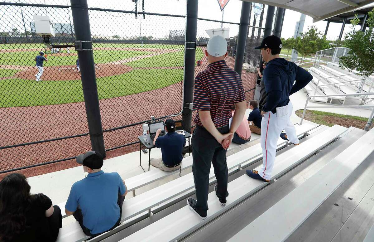 James Click, watching batting practice with hitting coach Troy Snitker at spring training, wants to emphasize people as he rebuilds the culture in Houston.