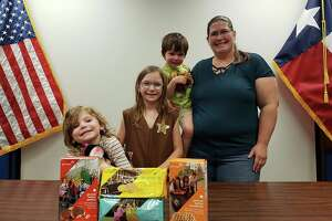 Eleanor Holbrook, 8, representing Girl Scout Troop 27137 donated about 42 boxes of assorted cookies to the office. Her brother, sister and mother, Amy, assisted her with the special delivery, according to the post.