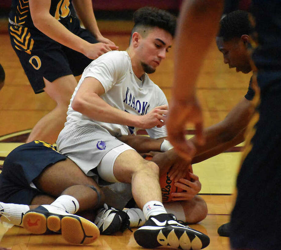 Collinsville forward Lorent Dzelandini battles for a loose ball on the court during Tuesday's game against O'Fallon at Belleville West. Photo: Matt Kamp|The Intelligencer
