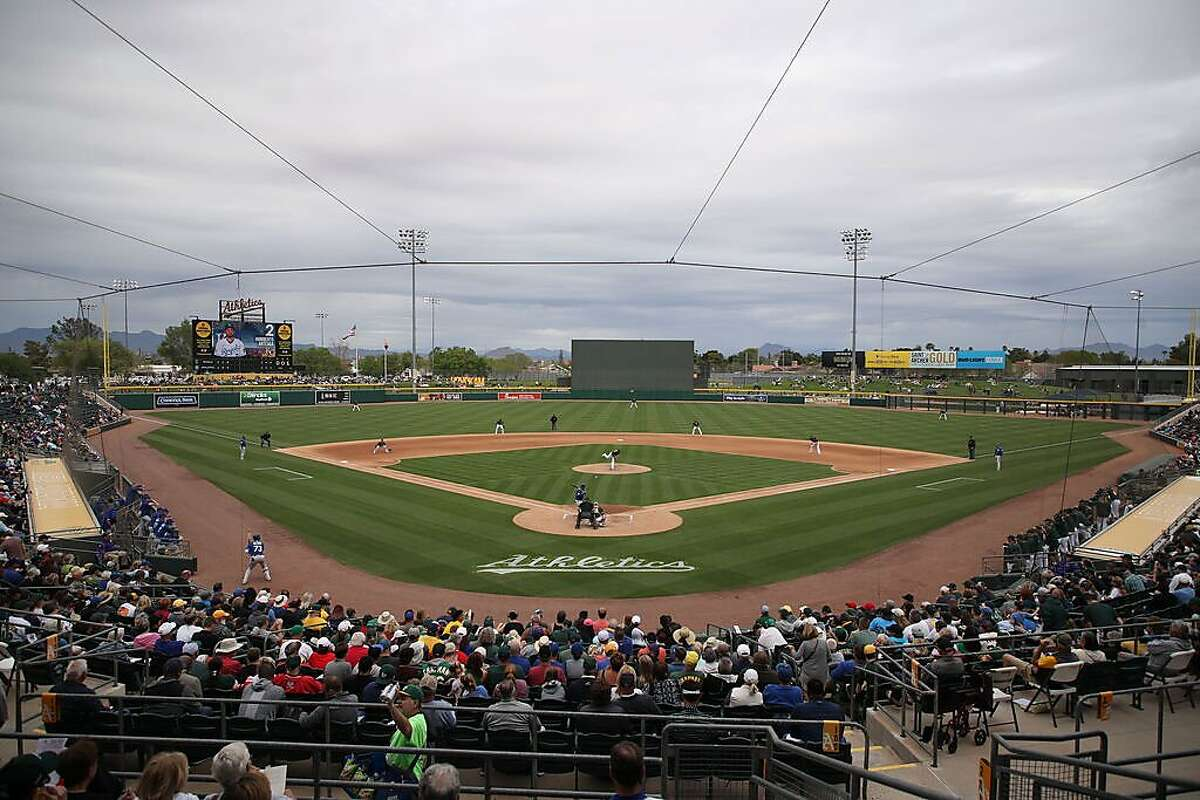 MESA, ARIZONA - MARCH 10: General view of action as starting pitcher Mike Fiers #50 of the Oakland Athletics pitches against the Kansas City Royals during the third inning of the MLB spring training game at HoHoKam Stadium on March 10, 2020 in Mesa, Arizona. (Photo by Christian Petersen/Getty Images)